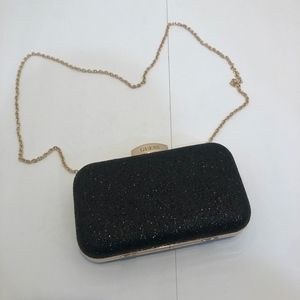 black and gold Guess clutch with crossbody strap